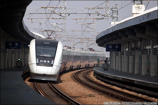2014年1月5日,广东东莞。 D7128次,深圳-广州东,驶离石龙站,石龙站将在2014年1月8日停用,广深线列车将停靠位于茶山的新东莞站。(IMG-7724-140105)