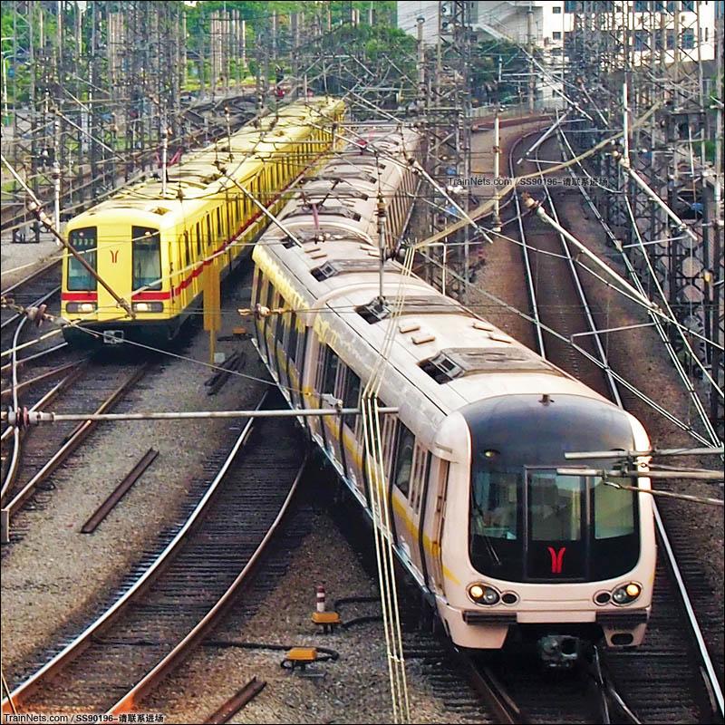 2014年6月17日。广州地铁西朗站。一号线庞巴迪与安达西门子列车同时进站。(图/SS90196-请联系进场)